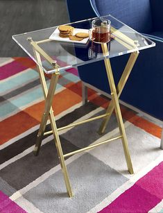 Love this! Brass and acrylic folding table