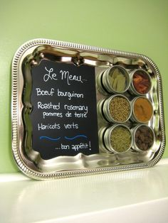Magnetic Spice Rack by SaltCitySpice. $42.00 OR DIY-buy world market magnetic canisters, thrift store tray, chalk board paint and chalk marker