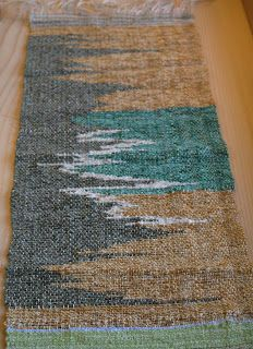 The warp was a fine cotton mixed with some metallic yarns on a 2 shaft loom. It was already on the loom so there was no time spent on warpin...