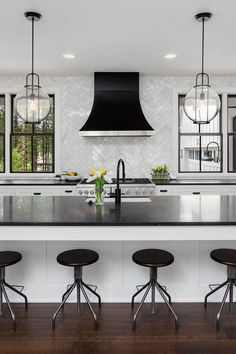 A simple design using white cabinets along with black countertop backsplash coveys a bold yet inexpensive and vibrant kitchen. White Cabinets White Countertops, Black Kitchen Countertops, Countertop Backsplash, Backsplash Ideas, Backsplash Black Granite, Black Counters, Quartz Countertops, Kitchen Redo, Home Decor Kitchen