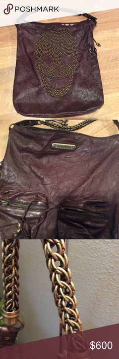 Thomas Wylde studded skull leather bag Skull motif is front and center, with a huge studded skull covering one side of the bag. This is one of the designers most popular hobo bags. Excellent condition. So many beautiful details. Gently used and in great condition. Thomas Wylde Bags Hobos
