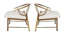 Vintage pair of brass lounge chairs.
