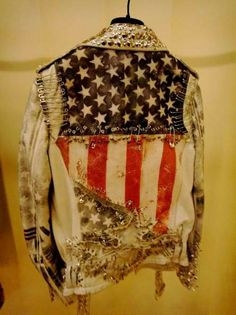worn punk denim jacket + American flag + safety pins