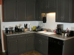 gray cabinets with black appliances