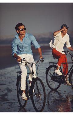 Blue long sleeve dress shirt and white pants