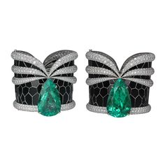 Set of one-of-a-kind Mystery of Muzo Colombian emerald cuffs.  Pear-cut 74.33 carats and 70.57 carats of vivid green Colombian Muzo emeralds in Art Deco-inspired, intricately detailed, hand-cut black spinel set into 18k white gold with 118.13 carats of round brilliant-cut diamonds. (=)