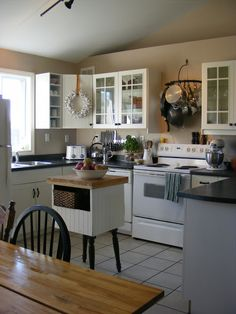 I love the cute kitchen island. The Complete Guide to Imperfect Homemaking: {OrganizedHome} Day A Peek Inside My Kitchen Cute Kitchen, Diy Kitchen, Kitchen Dining, Kitchen Decor, Kitchen Cabinets, Kitchen Ideas, Kitchen Tips, Glass Cabinets, Pantry Ideas