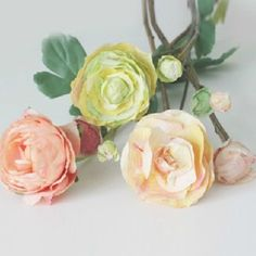 Learn to make these crepe paper flowers. Perfect for a wedding centerpiece, or accenting your home.