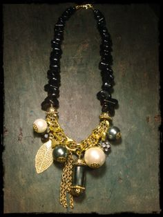 handmade necklace made of gold-plated chain, black jade stones and a wooden bead
