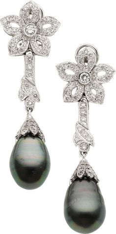 White gold earrings with black south sea cultured pearls and diamond.