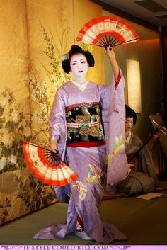 """A geisha apprentice or, """"maiko,"""" performs a traditional Japanese dance."""