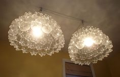 a pair of soda bottle bottom chandeliers - upcycled light fixtures