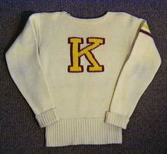 """1910's Kutztown University Football Sweater – Jersey. This vintage football sweater - jersey comes directly from Kutztown, Pennsylvania. The jersey is of exceptionally high quality and remains in solid EX-MT condition.. The body is off-white colored wool with a maroon and gold """"K"""" woven into the sweater."""