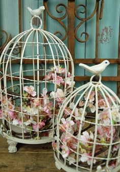 24.99 SALE PRICE! This set of white, domed bird cages make for the perfect addition to a romantic wedding. Fill these cages with candles or small vases fille...