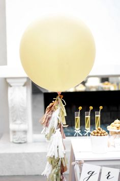 Today I'm showing you how to make balloon tassels.ch to your party decor. Your  guests will go nuts over them, especially when they are paired with these  giant gold round balloons. So let's get started ... ...