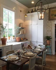 created an eat-in kitchen for the southerner who loves to entertain. An antique table and chairs pop against the backdrop of white cabinetry and gleaming appliances. And of course the table is all set and ready for the next dinner party! Kitchen Nook, Eat In Kitchen, Kitchen Pantry, Country Kitchen, Diy Kitchen, Kitchen Dining, Kitchen Decor, Kitchen White, Design Kitchen