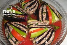 Yelpaze Kebabı 2_ 5 pieces of eggplant For filling; 300g minced ...~ 10.58 ounces. 1 clove garlic 1 small size protects grated onion Salt, black pepper, red pepper flakes A little parsley 1 seed tomatoes 2 green pepper grains For the above; 1 teaspoon tomato paste 1 teaspoon hot pepper sauce 1 cup warm water Salt -03.22.2016