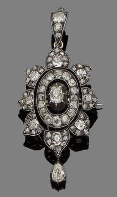 A diamond brooch/pendant, circa 1870  Modelled as a stylised flowerhead, set throughout with cushion-shaped and rose-cut diamonds, suspending a pear-shaped diamond in pinched collet-setting, mounted in silver and gold, cushion and pear-shaped diamonds approx. 4.00cts total, detachable brooch fitting, length 6.1cm