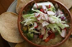 Mexican chicken pozole recipe, pozole blanco, traditional dish of Guerrero, Mexico, made with hominy, chicken, and several garnishes.