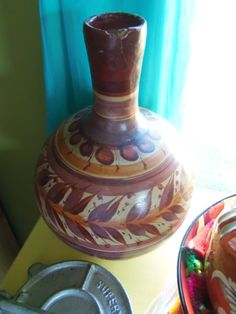 Old Mexican Pottery: I actually have this water pot, mine has the matching mug on top. Really nice pieces, with No chips.