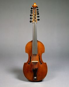 """Joseph Gagliano (Italian, active 1770–1800) Viola d'amore, ca. 1780 Spruce, maple, ebony; 10 7/16 x 3 11/16 x 35 15/16 in. (26.5 x 9.3 x 91.3 cm) The Metropolitan Museum of Art, New York, Gift of H. H. Schambach, 1981 (1981.480) This viola d'amore, typical of the late eighteenth century, has six sympathetic strings that are not played but ring in """"sympathy"""" with the six main bowed strings."""