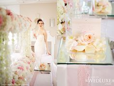 Love the glass invitation on the right side of the picture! A simple glass box with the invitation taped to the top and rose petals in the box.