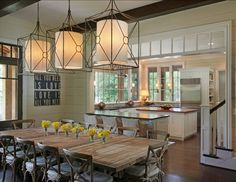 Natural dining room and open kitchen with hidden stairs in between | Splash Kitchens & Bath LLC