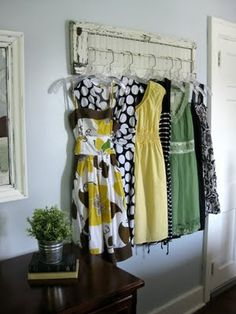 My *PINK* Life: Creative Clothing Organization  Another cute idea for hanging dresses! Using an old window shutter.