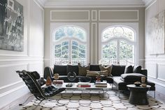 Contemporary Eclectic Modern Furniture: A living room with contemporary art, European-style windows, and B&B Italia's Charles sofa.