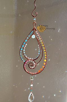 Love sparkly, copper wire art? Come check out the rest of our collection here: https://www.etsy.com/shop/MargayAndBinturong/items?section_id=21415727 This swirly tear drop Suncatcher is eye-catching, simple, yet flowy, and chock full of glittering crystals! It is reminiscent of