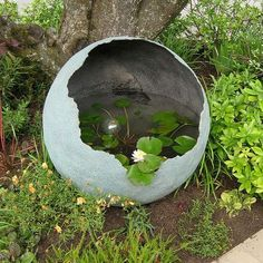 Spray the inside of your concrete sphere with Rust-Oleum LeakSeal and fill with water for a pretty water feature.:
