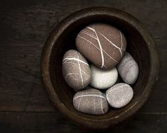 pebbles in a wooden bowl