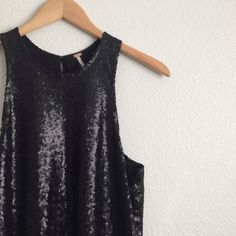Black Liquid Shine Dress Brand new with tag. Sequin dress with open back, back clasp closure and drop waist.              15% OFF Bundles of 2+ items Find me on Instagram @see.seasew Free People Dresses Mini