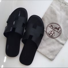 """Hermes sandals Super luxurious """"Hermes"""" Izmir black sandals. . They come with a dust bag ****if you request for it. Real leather. size 43. They're used so the bottoms are not perfect. BUYER NOTICE NOT HERMES Shoes Sandals"""