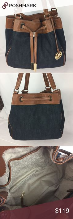 """Michael Kors Marina Denim & Leather Drawstring Condition Notes: Grade A-  Shows some slight wear on corners and minor hardware scratches.  Grab hold of easygoing style with this denim and leather carryall. Double handles with 11"""" Drop. Magnetic snap closure. Gold tone hardware. Interior: 1 zip pocket, 3 open pockets, 1 phone pocket, 1 key fob.  14"""" W x 11.5 H x 6.5 D   Thank you for your interest! No Trades please. Michael Kors Bags Totes"""