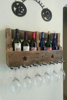 Handmade Rustic Vintage Wine Rack repurposed horse shoes for wine glass holders & an old pallet; holds six bottles and six glasses and brings a Southern Swag to your wine etiquette ;)Find us on Facebook at Southern Branded Custom Crafting.