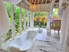 This beautiful Bali bathroom is surrounded by windows, letting in all the nature around it! #Indonesia #Vacation #Rental