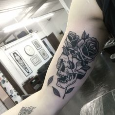 traditional style black work skull and flowers tattoo / pin: theestorysofar