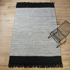 Free Shipping.  Shop leather dressage runner 2. 5'x8'.   Handwoven on a traditional pit loom using soft leather upcycled from shoe and bag factories.  Warm tonal grey weaves a modern neutral field banded by black and edged in exaggerated fringe.