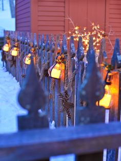 Light the way from winter into spring. Amy's pretty fence was a great backdrop for a garland I made from rope festooning small battery powered lanterns and pine cones stars. Buy yardage of heavy Rope at Home Depot or Lowes and swag away. Christmas Swags, Christmas 2015, Simple Christmas, Christmas Decorations, Xmas, Christmas Baby, Christmas Stuff, Christmas Ideas, Battery Powered Lanterns