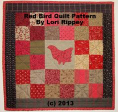 Small quilt in reds & greens with appliqued bird. You can find the E-Pattern on my PT: www.picturetrail.com/homespunprimsbylori