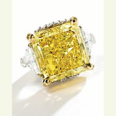 Property of a Distinguished Lady: Magnificent Fancy Vivid Yellow Diamond and Diamond Ring, 51.75 carats