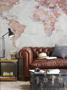 map wall, leather sofa, trunk coffee table