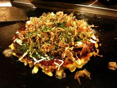 #okonomiyaki, Osaka -  dubbed 'Japanese pizza', it's a mixture of seafood or meat, vegetables and batter cooked on a hot griddle. The tasty treat is topped with special sauce, mayonnaise, grated seaweed and bonito fish flakes.