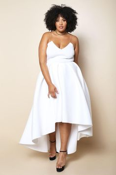 Look glamorous for any special event with this plus size evening gown. Made with a low scoop neckline, invisible cami straps, contoured stitching along the bodice, natural waist, and breathtaking high-low skirt. Made with elegant pleats along a stunning scuba fabric. Unfinished hem.