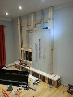 This family built a fireplace for their family room. Fireplace Tv Wall, Basement Fireplace, Build A Fireplace, Fake Fireplace, Fireplace Built Ins, Fireplace Remodel, Electric Fireplace, Living Room With Fireplace, Fireplace Design