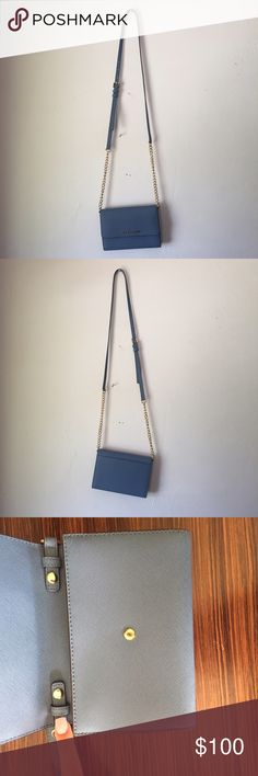 Michael Kors JetSet Crossbody-Blue Cross-body or Clutch? This bad boy can do both! In perfect condition; never used! With adjustable handle to wear as a cross-body or remove them through the buckles and make it a small clutch. There's a cardcase slip inside and it's perfect for casual days or dressed up nights!🌞👗💋👠👛 Michael Kors Bags Crossbody Bags