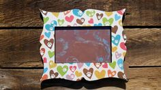 Check out this item in my Etsy shop https://www.etsy.com/listing/241253770/colorful-paw-print-frame-4x6-photo
