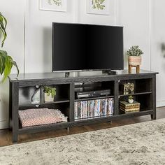 Beachcrest Home Sunbury TV Stand for TVs up to 78 inches Color: Black, Fireplace Included: No Fireplace Logs, Black Fireplace, Fireplaces, Tv Stand With Storage, Cool Tv Stands, Flat Panel Tv, Wholesale Furniture, Classic Furniture, Adjustable Shelving