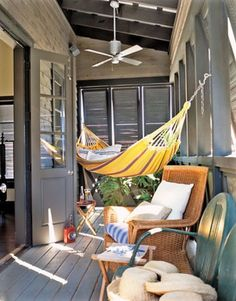 Hammock This porch was made for relaxation. Louvered shutters keep the midday sun at bay while overhead fans get the air circulating. A wicker chair with plush cushions and a Brazilian hammock provide unbeatable lounge spots. Style At Home, Outdoor Spaces, Outdoor Living, Outdoor Hammock, Hammocks, Camping Hammock, Diy Camping, Patio Hammock Ideas, Hammock Balcony